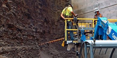 Installing a soil nail at the Harmon Parking Deck, University of Arkansas - Fayetteville, AR.