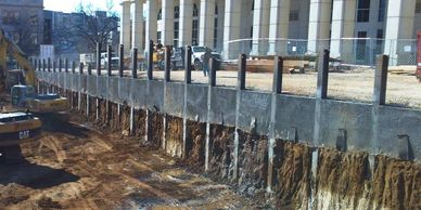 H-piles with shotcrete lagging and tiebacks for the University of Arkansas Vol Walker Hall ESS.
