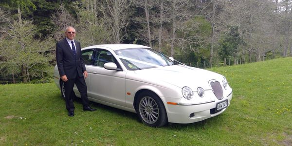 The chauffeur and owner, Keith with a Jaguar sedan