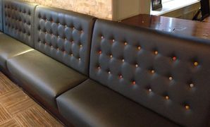 Floating buttoned back banquette seating