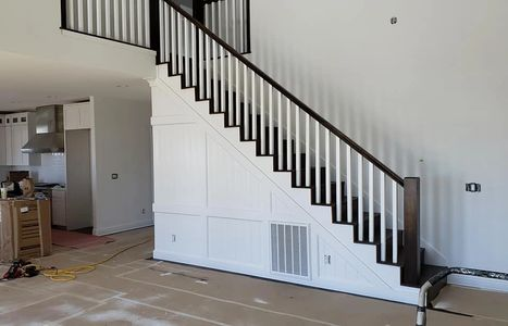 interior newel posts and handrail installation. custom wall panel, wainscoting, Lincoln city, Oregon