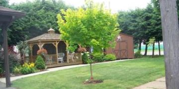 A lovely landscaped yard and gazebo bekons you to relax and enjoy our peaceful outdoors.