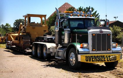Hauling bulldozer, tractor trailer, low boy trailer, 2001 Peterbilt, 1999 Talbert low boy trailer