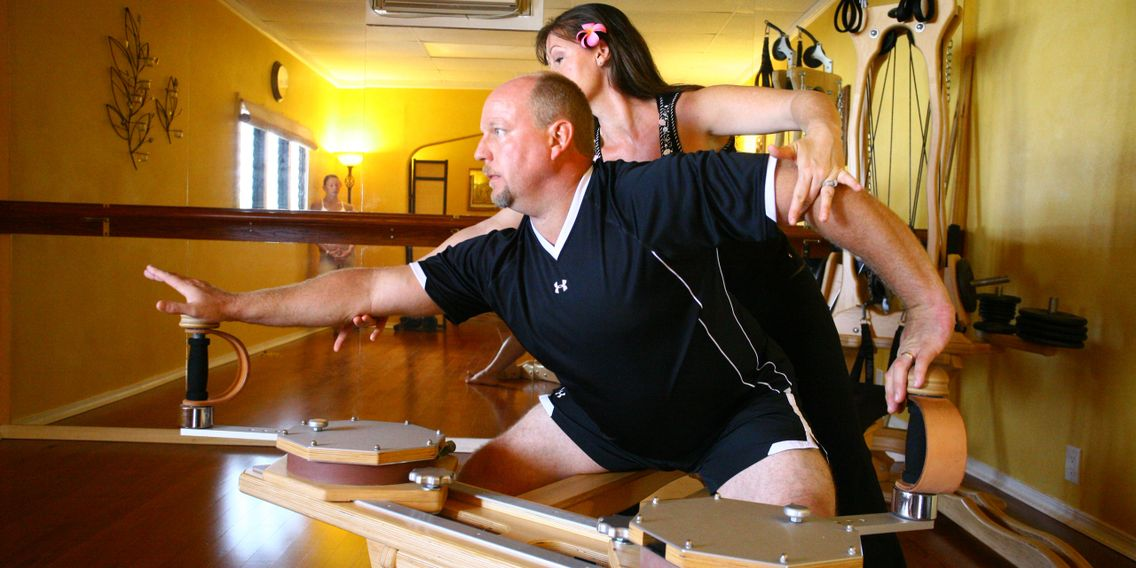 Laura and Steve spiraling Gyrotonic with Blossoming Lotus Pilates in La Verne CA
