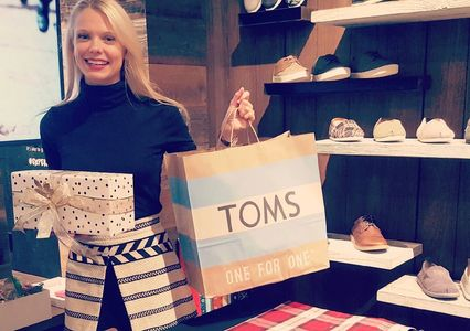 Annabelle wrapping at an on location event at TOMS