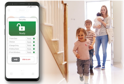 Mom with three young children walking through front door featuring security system app