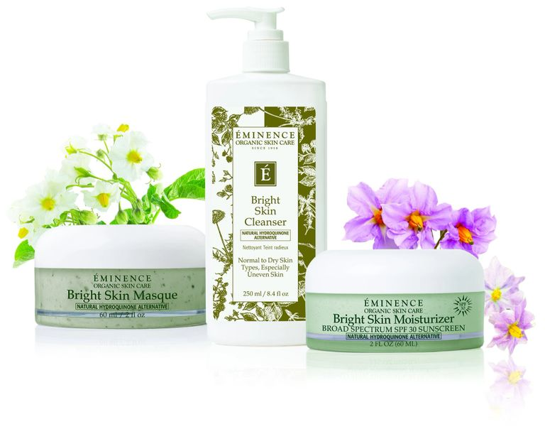 Eminence organics products grouped with flowers