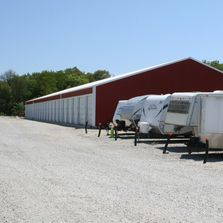 Outdoor and Medium Size Storage Units with door and concrete floor to storage boats, campers and RVs