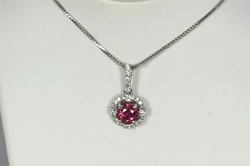 white gold ruby and diamond halo pendant