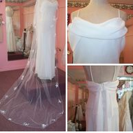 White wedding dress with long veil at