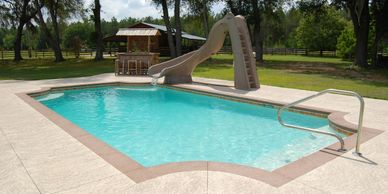 Concrete pool with slide
