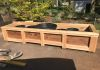 Eight Foot Solid Cedar Planter Box with Raised Open Slat Bottom for Ample Drainage of Potted Plants.