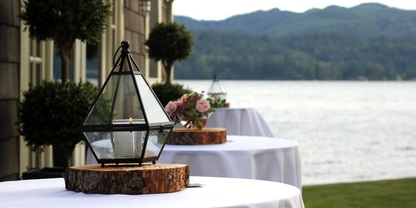 Cocktail tables at a lake side summer party.
