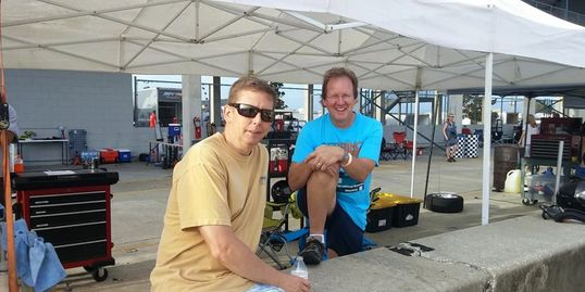 Customers, Bob Varga and Don Chrzan, (left to right) hang out in the pit after an event.