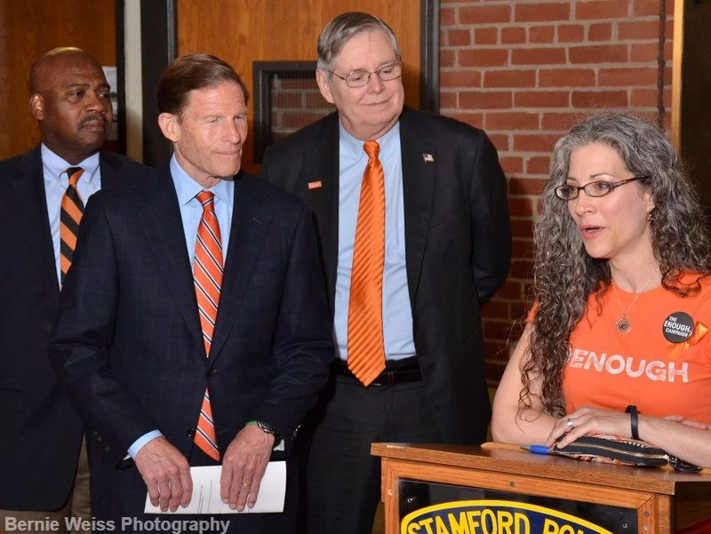 Shira Tarantino speaks as Stamford Mayor Martin, CT Sen. Richard Blumenthal, Michael Hyman look on.