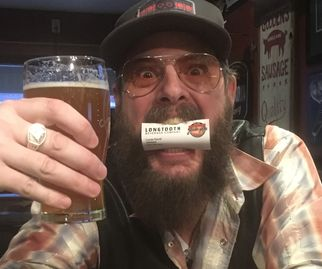 Ken Tizzard, musician enjoying a Longtooth pale ale. currently brewed at Churchkey Brewing company