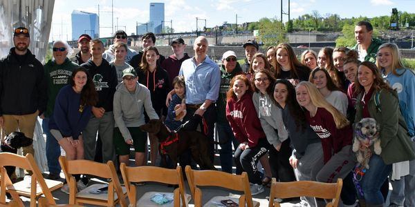 Team photo taken at the Penn AC boathouse the day of the Catholic races in 2019.