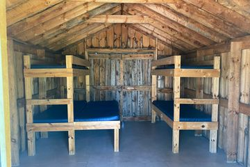 Rustic Cabin 2 sets of bunk beds - 1 double, 3 singles.
