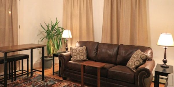 "Relax in the family room. Shared space.  Wifi & 40"" Cable and Samsung SmartTV."