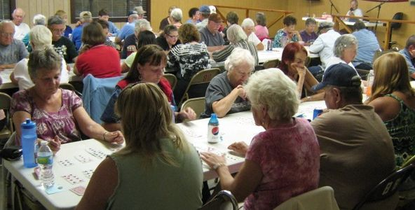 Park residents and guests playing card bingo in our rec hall.