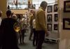 Patrons observing student artwork at the 2018 Art and Music Concert at V. Sue Cleveland High School.  Photo Credit:@2018 Kathleen Messmer Photography