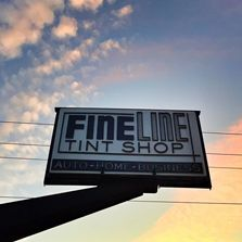 Sign for fine line tint shop window tinting business