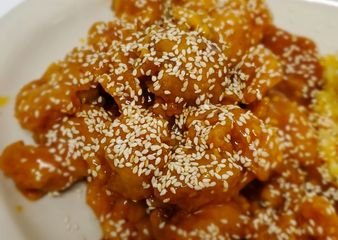 Sesame Chicken.Crispy dark meat chicken nuggets tossed in sesame sauce with a touch of sesame seeds
