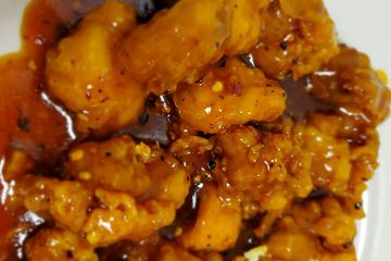 General Tso Chicken. Crispy dark meat chicken nuggets tossed in a spicy yet sweet General Tso sauce
