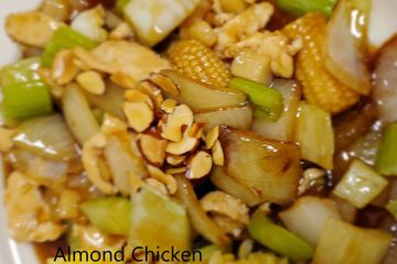 Almond Chicken, Onions, celery, and water chestnuts stir fried in a light brown sauce