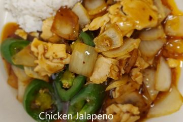 Chicken Jalapeno. Jalapeños and onions stir fried in a brown sauce.