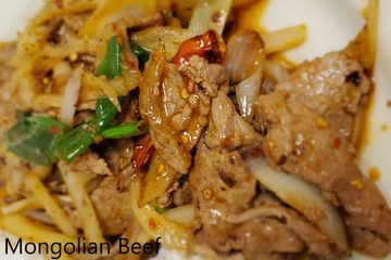 Mongolian Beef.Green and white onions stir fried in a spicy red pepper sauce