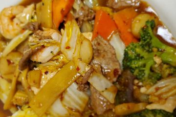 Triple Delight. Shrimp, chicken, and beef with mixed vegetables stir fried in a spicy brown sauce