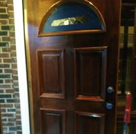 This project required stripping and  re-staining this door to its original beauty.