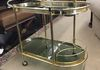"Mid Century Modern brass and glass rolling 2 tier bar cart 33 1/2""L x 18 1/2""W x 27 1/2""H"