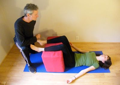 Owner Jeff using posture therapy with client