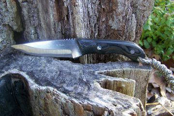 This knife is a great size for an every day user. The handle material is canvas micarta. Extremely d