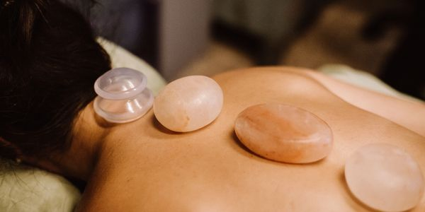 hot stone and cupping combined African american massage therapist