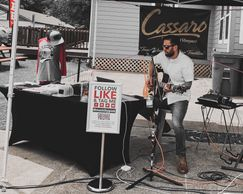 Grades Of Absolute Truth performing with an acoustic guitar outside of Cassaro Winery