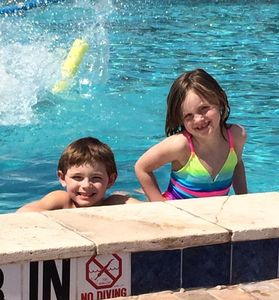 Kids having fun in a well Maintained pool.
