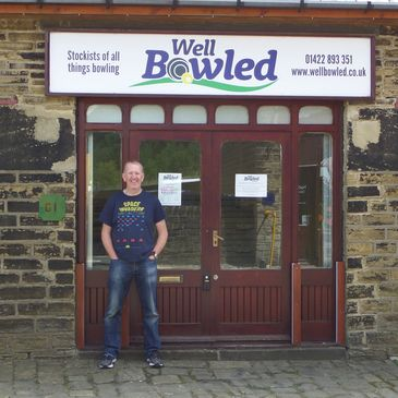 shop manager standing outside the well bowled shop