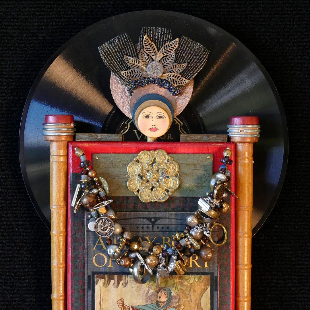 Guardian of The Arts. Created from record, Cracker Jack charms, book cover, spools, beads.
