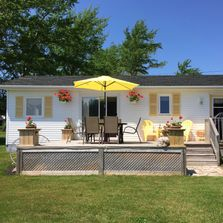 Luxury Cottage near Greenwich Beach. Beautiful waterview & great amenities. Lots of extras. Relax!!