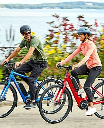 "Couple having fun while riding Bosch electric bikes rented at ""Bike Rental Tenerife"" in Costa Adeje."