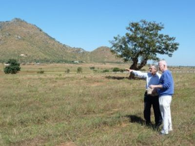 Fr. Podgrasjek & Fr. Henriot, project leaders, inspect the site of the future Loyola Jesuit School