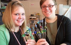 Eastlake High School Seniors Kaye and Alexa learning Glass Beadmaking