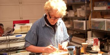 Ana working on her open face glass tiles during a private lesson at Striking Art.