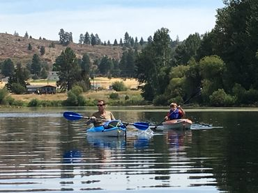 Kayaking on Agency Lake in Oregon. Mark Cobb and son Jack.