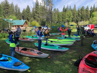 Giving kayak lessons training to 3rd and 4th graders from Klamath County at Harriman Springs Resort.