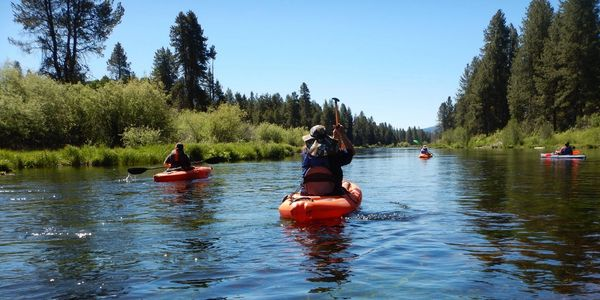 kayaking down the williamson river near crater lake national park in chiloquin, oregon