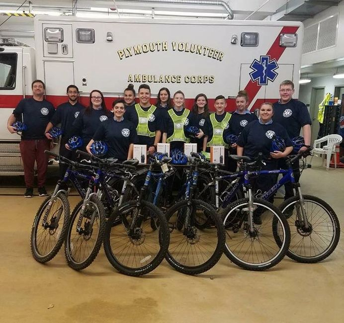 Members of the Explorer Bike Team pictured in front of ambulance 111-2